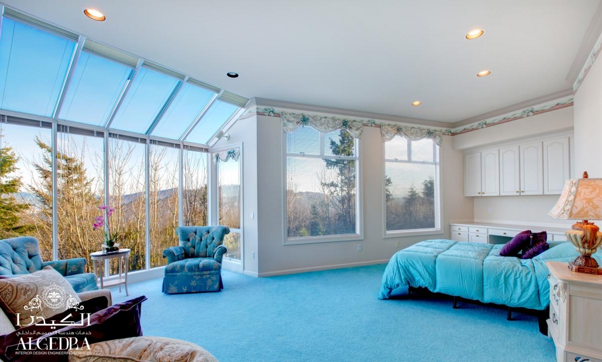 glass-walled bedroom