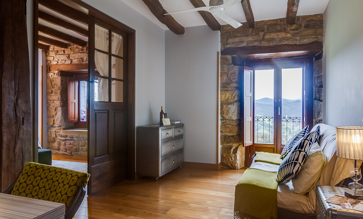 Windows Are Simple And Left Bare To Take Advantage Of Unfiltered Natural Light In Tuscan Interior Design